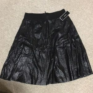 Dresses & Skirts - Black faux leather skirt with pattern